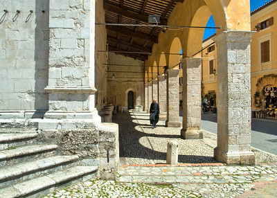 Close crop - Monk walks outside church in Norcia, Umbria